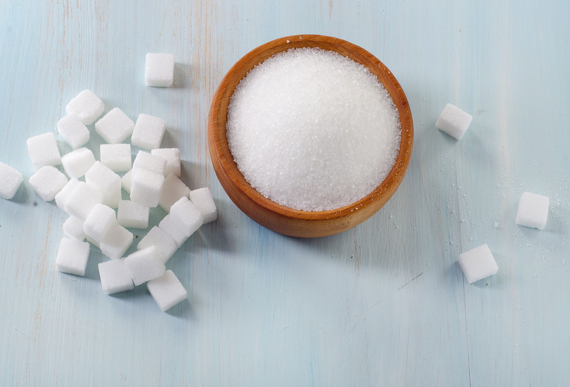Sugar on wooden table. Selective focus