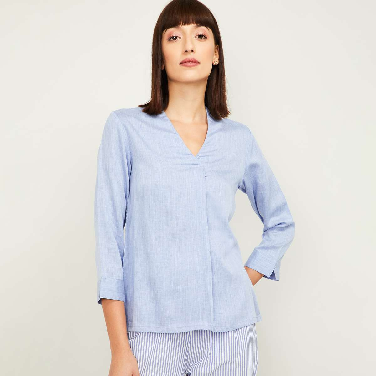1.AND Women Solid V-neck Top