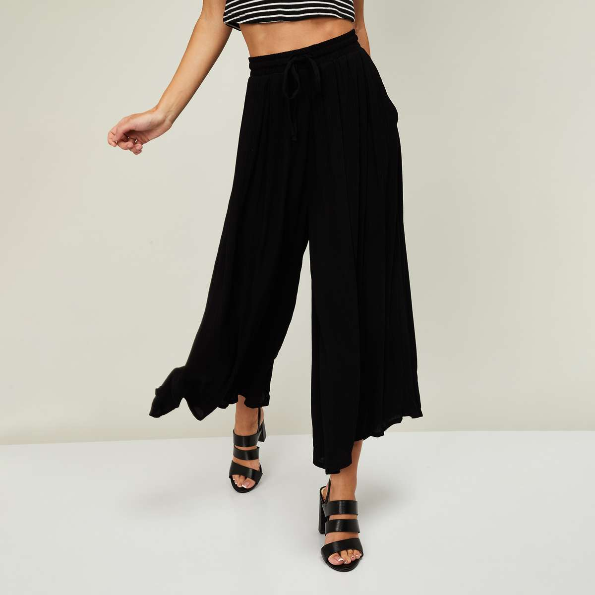 3.CODE Women Solid Flared Palazzos